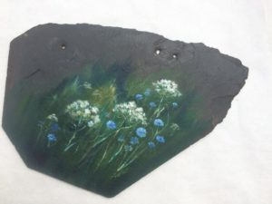 Slate roof tile from Shepherd's Corner farm house. Blue and white flowers painted on it.