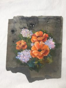 Slate roof tile from Shepherd's Corner farm house, orange flowers painted on it.