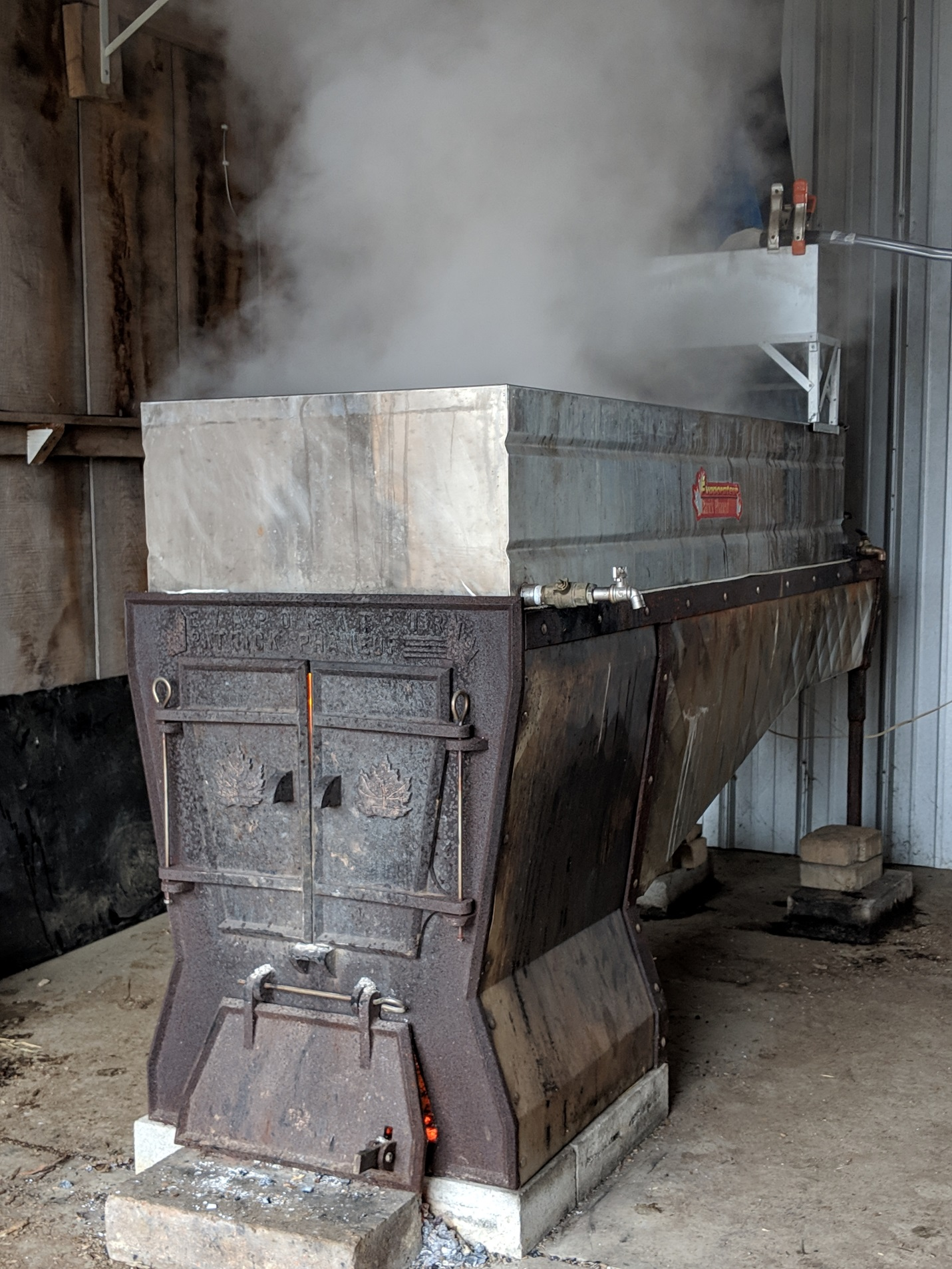 Evaporator boiling down maple sap into syrup.