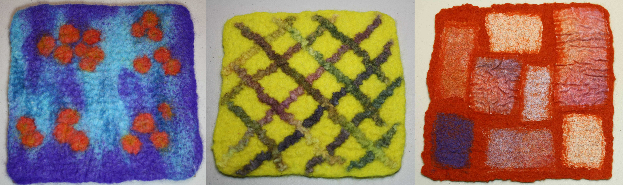 Three felted squares side by side. Each is a different design. First is blue background with orange-red dots, second is yellow background with multi color crosshatch lines, and the third is red background with varying sizes of rectangles of contrasting colors.